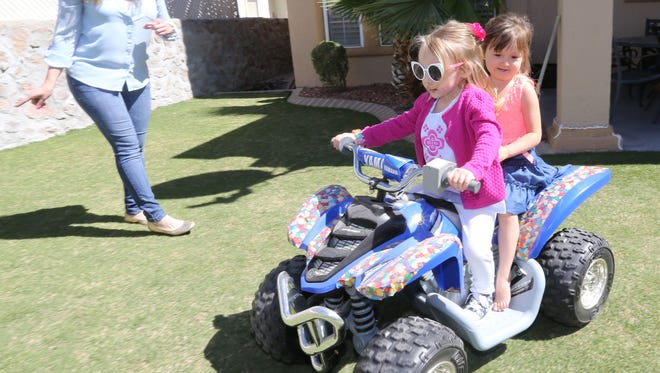 Alyssa Tavizon-Spinks watches her daughter Zoey, front, and Ella Musshorn ride a motorized car. The two girls were enjoying a play date. Three-year-old Zoey has been living with cystic fibrosis since she was 16 days old.