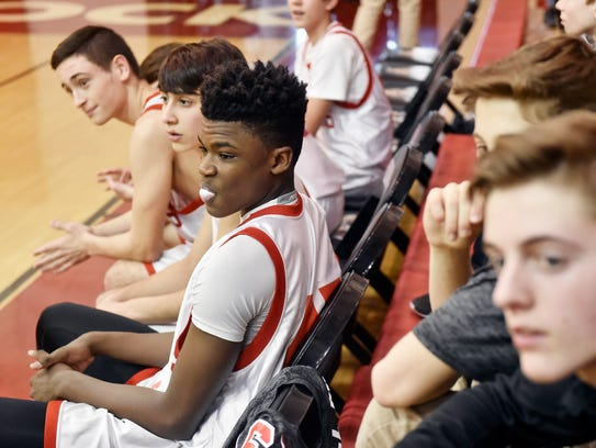 Jarace Walker, center, waits for a ninth-grade basketball