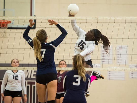 Fort Pierce Westwood's Reyanah Burr goes up for a spike