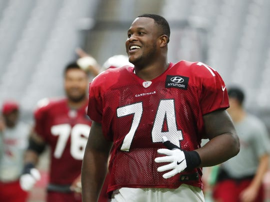 Arizona Cardinals offensive tackle D.J. Humphries (74) laughs during camp at University of Phoenix Stadium in Glendale, Ariz. August 8, 2018.