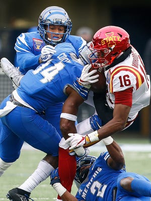 The Memphis defender stops Iowa State receiver Marchie Murdock (right) short of a first down during fourth quarter action of the AutoZone Liberty Bowl in Memphis, Tenn., Saturday, December 30, 2017.