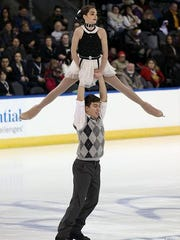 Jacob Nussle does a lift with partner Cora DeWyre at the U.S. Figure Skating Championships in Kansas City.