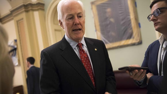 Sen. John Cornyn speaks with reporters outside his office at the U.S. Capitol on May 10, 2017.