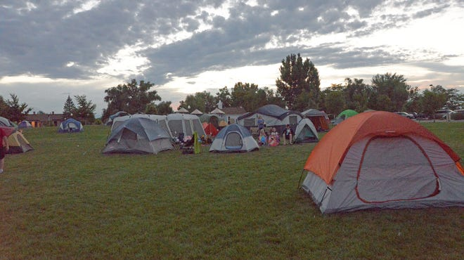 Dozens of tents are pitched Friday night in Boardwalk Park as part of the Windsor Parks and Recreation department's family campout and movie in the park.