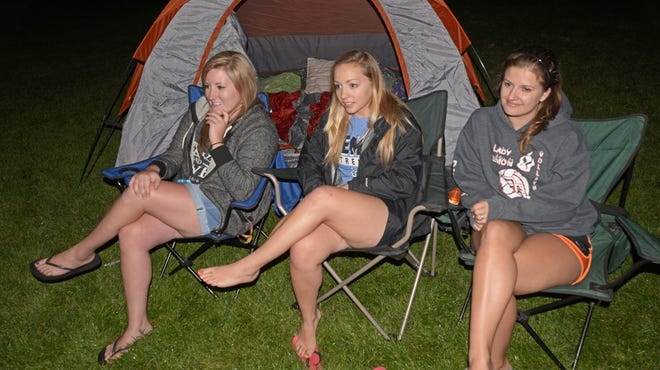 Three women passing through Northern Colorado on vacation decided to stop in Windsor for the day and found themselves camping out at Boardwalk Park on Friday and taking in the outdoor movie. From left, Chelsea Wagner from Holcomb, Kan.; Hannah Savage of Dodge City, Kan.; and Taya Elliot, from Bella Vista, Ark.