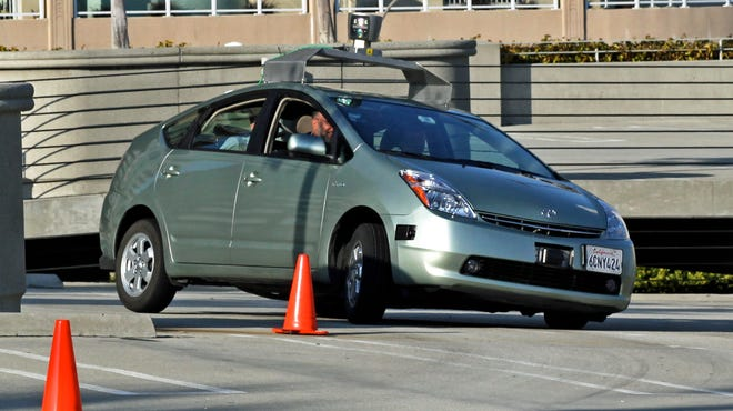 """Driverless — or """"autonomous"""" — cars may be commonplace by 2020, some analysts say, and are touted by proponents as more sustainable than their driven counterparts. But convenience factors could tip the scales the other way and mean more and larger vehicles on the road. Pictured: Google's prototype driverless car, a converted Prius, undergoing testing."""