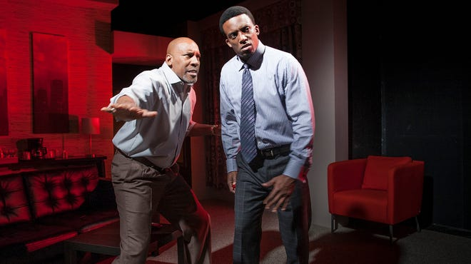 "Ezra Knight, left, and Garrett Lee Hendricks star in ""Playing the Assassin,"" a play about football, hero worship and violence at Penguin Rep in Stony Point. David Robson's play opens this weekend and runs through Oct. 12."