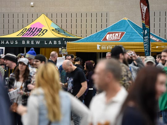 Patrons flock to booths serving craft beer, cider and other adult beverages at the 2017 St. Cloud Craft Beer Tour.