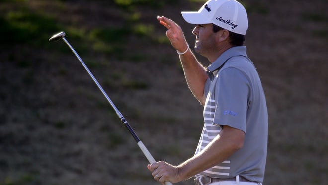 Ryan Palmer misses an eagle putt on the eighth hole Friday.