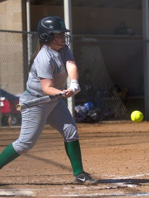 Farmington's Brianna Blades connects on a pitch for a base hit against Bloomfield on Friday at the Farmington Sports Complex.