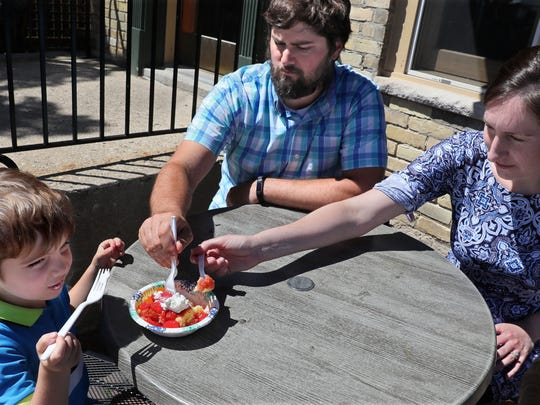 Warren Bublitz, 3, of West Bend gets help eating his