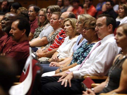 Thirty four Madison school district staffers (teachers, administrators and other employees) with more than 20 years in the district are honored at Madison High School on their first day back at school. September 1, 2016, Madison, NJ