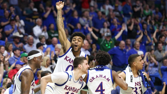 Kansas Jayhawks guard Frank Mason III (0) celebrates with his teammates after the game against the UC Davis Aggies in the first round of the 2017 NCAA Tournament at BOK Center.