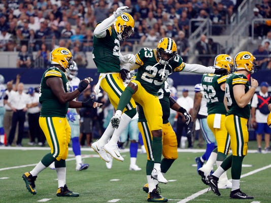 Green Bay Packers' Damarious Randall (23) celebrates with teammates after intercepting a Dallas Cowboys' Dak Prescott pass and returning it for a touchdown in the second half of an NFL football game, Sunday, Oct. 8, 2017, in Arlington, Texas. (AP Photo/Michael Ainsworth)