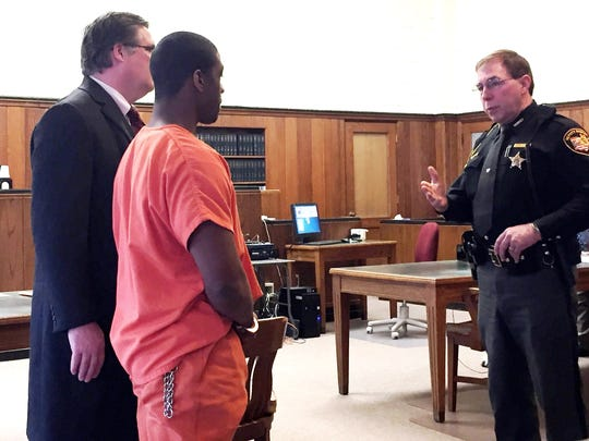 Willie Arrington is led out of court after being sentenced to nine years for burglary. At left is his attorney, Tim Braun.