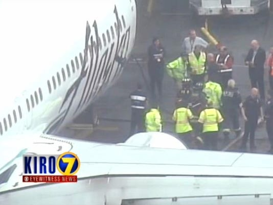 Alaska Airlines Worker Trapped