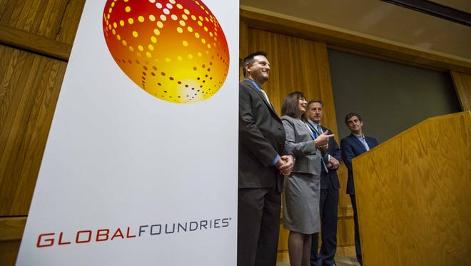 GlobalFoundries' Janette Bombardier, second from left, speaks as the company announces a $55 million investment in equipment and infrastructure at the GlobalFoundries Fab 9 in Essex Junction during a news conference on Wednesday, November 4, 2015. With Bombardier are Dale Miller, director of fab operations, Gov. Peter Shumlin and Burlington Mayor Miro Weinberger.