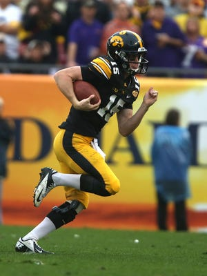Iowa quarterback Jake Rudock runs the ball against LSU in the Outback Bowl on Wednesday, Jan. 1, 2014, in Tampa, Florida.