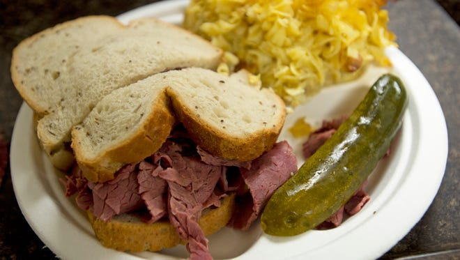 A full plate at the York JCC Jewish Food Festival: from left: a corned beef sandwich on rye, kugel and a pickle.