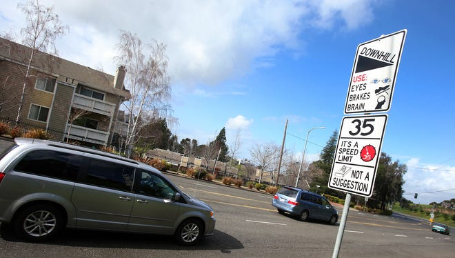 In this Feb. 9, 2015 photo, a new traffic sign sits along Hayward Boulevard in Hayward, Calif. The city is using humor to get drivers to slow down and pedestrians to pay attention. (AP Photo/The Contra Costa Times, Aric Crabb)