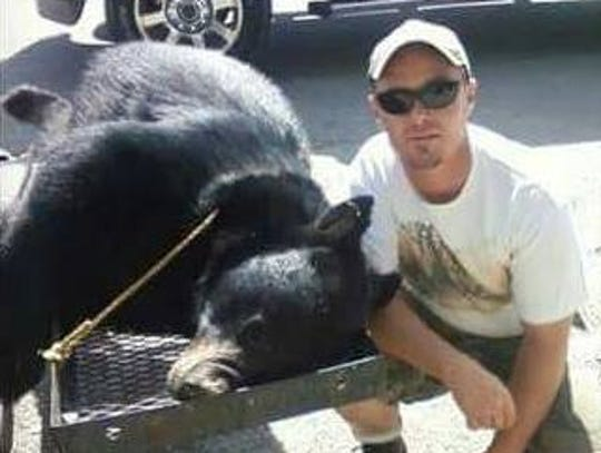Jonathan Shull of Mountain City, Tenn., killed this 315-pound black bear with bow and arrow on Doe Mountain with Paul Neighbours Jr. of Hendersonville.