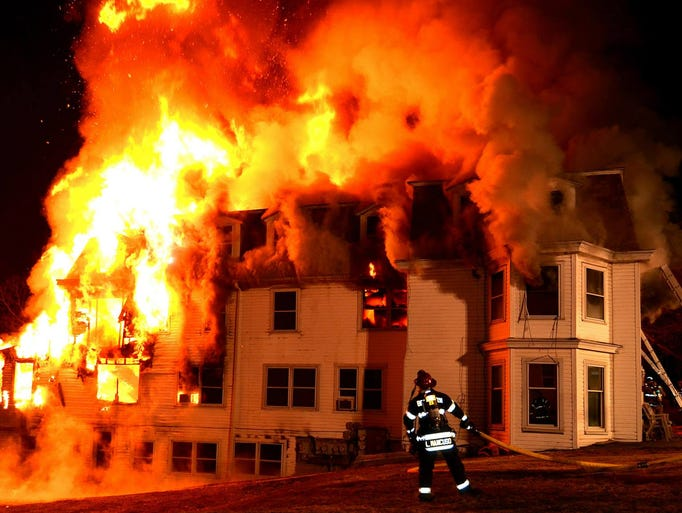 Building On Fire : Fire engulfs apartment building