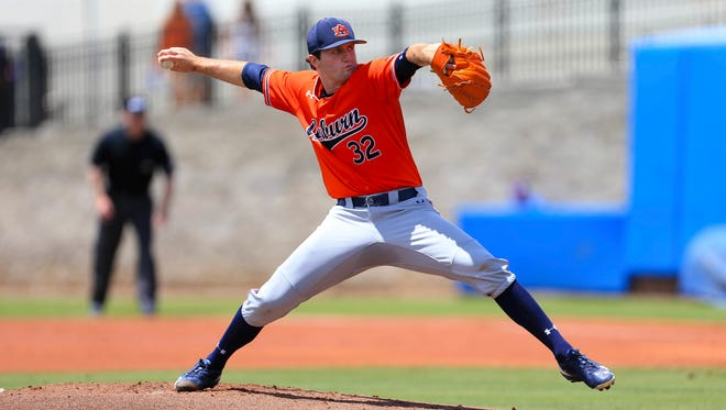 Auburn pitcher Casey Mize throws against Florida during the first inning of an NCAA Super Regional college baseball game Saturday, June 9, 2018, in Gainesville, Fla.