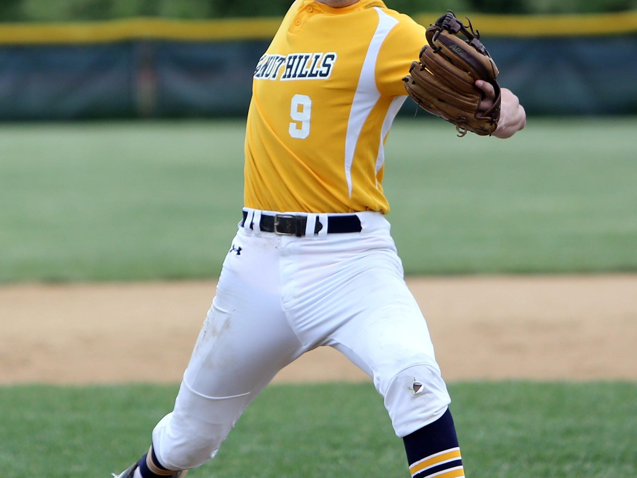Walnut Hills pitcher Cole Murphy propels the ball forward against La Salle May 14.