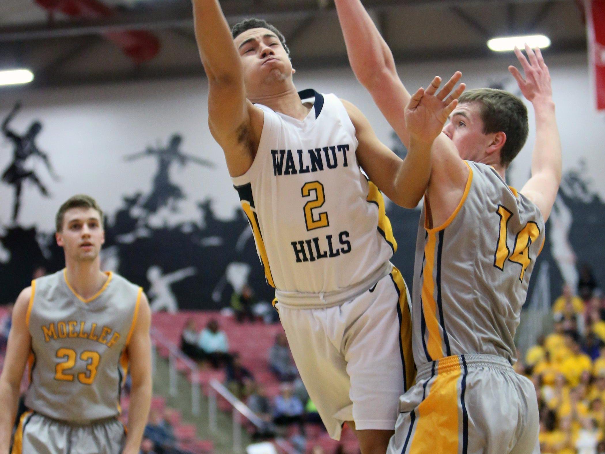 Walnut Hills forward Michael Davenport (2) attacks the basket in the sectional tournament last season.