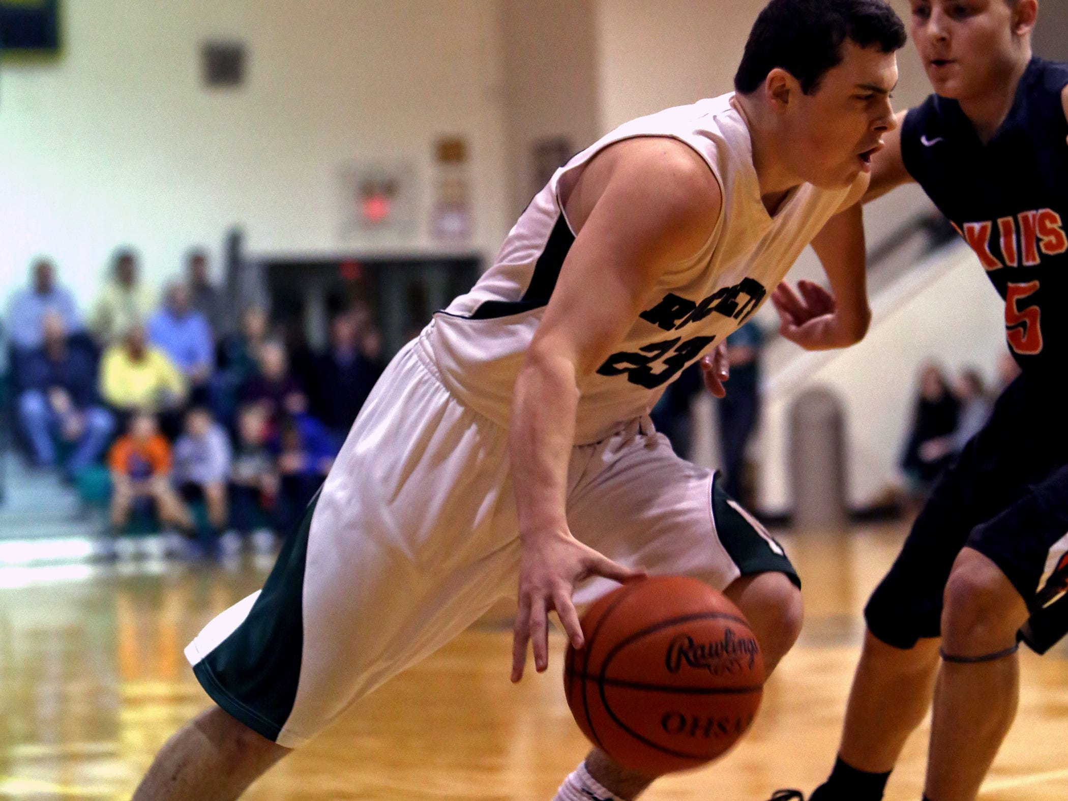 McNicholas guard Greg Kent drives to the basket against Anderson Feb. 10.