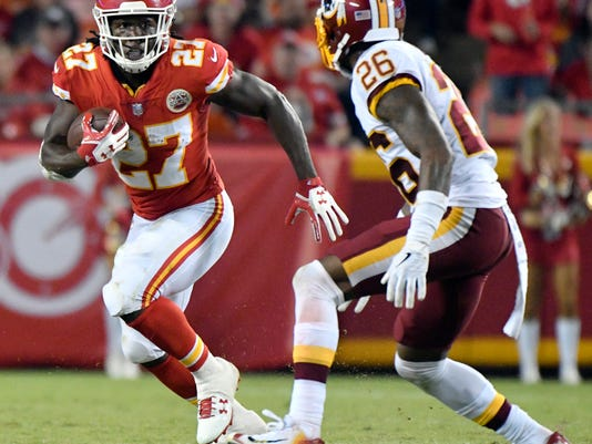 Kansas City Chiefs running back Kareem Hunt (27) runs away from Washington Redskins cornerback Bashaud Breeland (26) during the second half of an NFL football game in Kansas City, Mo., Monday, Oct. 2, 2017. (AP Photo/Ed Zurga)