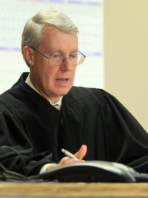 Sixth Judicial District Judge Christopher Bruns speaks to attorneys during Alexander Kozak's pretrial conference at the Linn County Courthouse in Cedar Rapids on Friday, March 18, 2016. Kozak is charged with first-degree murder in the death of Andrea Farrington at the Coral Ridge Mall last June.