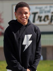 Kaleb Williams poses for a photo at West High on Tuesday,