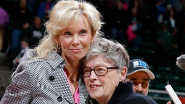 Michigan State coach Suzy Merchant, left, gets a hug from MSU president Lou Anna Simon after Merchant picked up her 400th career win against Minnesota Sunday, Feb. 21, 2016, in East Lansing, Mich. Michigan State won 114-106.