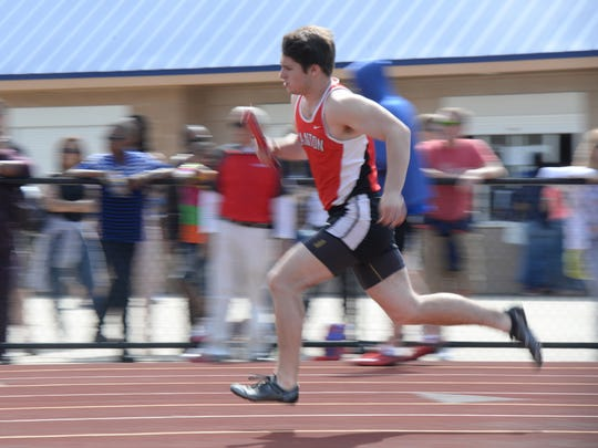 Canton's Sam Pennock in the 4 x 200 relay at the second
