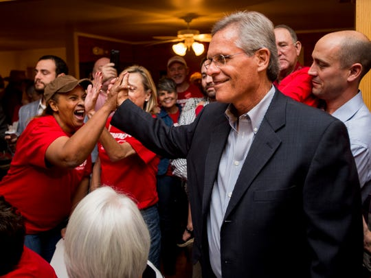 Keith Stutes, a candidate for District Attorney, celebrates with supporters after being projected as winner of the race over incumbent District Attorney Mike Harson during an election party at Acadian Village in Lafayette, La., Tuesday, November 4, 2014. Paul Kieu, The Advertiser