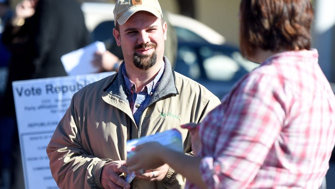 Jeremy Shifflett, a write-in candidate for Augusta County School Board's Beverley Manor District, campaigns outside the Augusta County Government Center  voting precinct in Verona on Tuesday, Nov. 3, 2015.