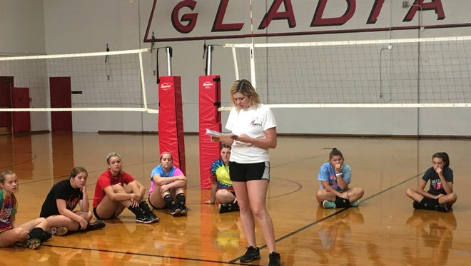 Nyssa Stapleton, the new Riverheads volleyball coach, talks to her players prior to tryouts Monday afternoon in the school's secondary gym.