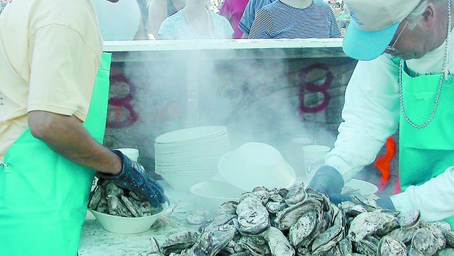 Steamed oysters are prepared during a recent Oyster Festival held on Chincoteague.