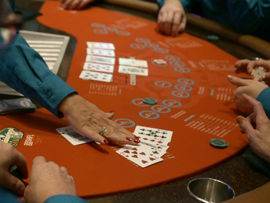 Dealers go through training at one of the gaming tables.