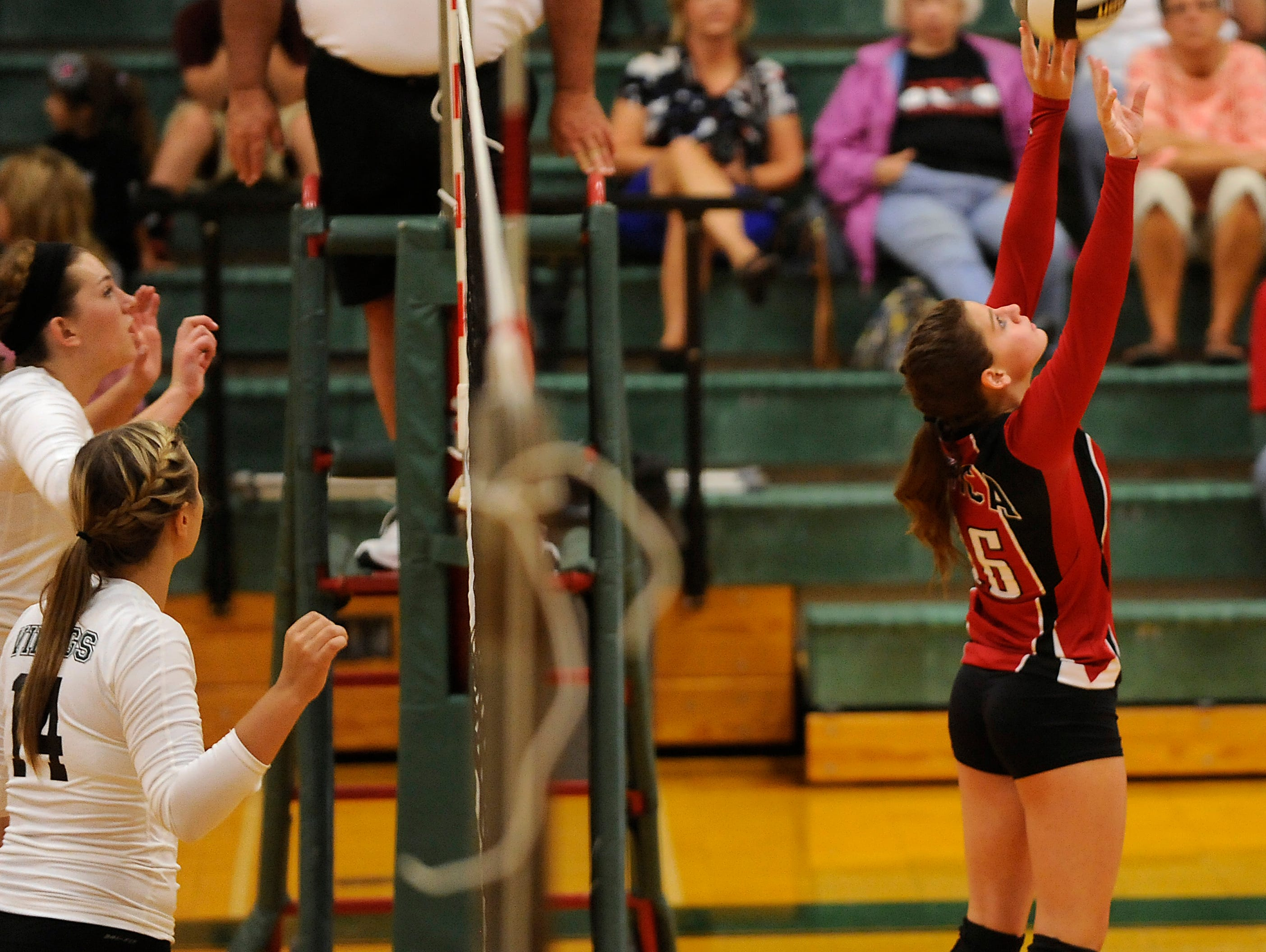 Northridge's Savannah Legg and Jamie Swickard prepare to block as Utica's Brooke Maxwell sets up a teammate for a hit during Thursday's Licking County League match.