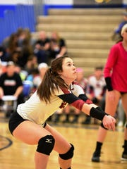 Churchill's Colleen McGowan comes up with the dig in Tuesday's regional semifinal win over Renaissance.
