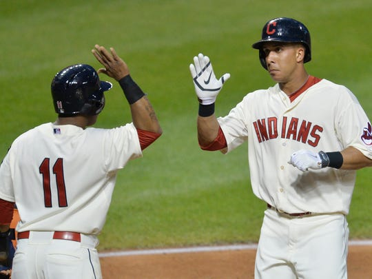 Cleveland Indians left fielder Michael Brantley (right) celebrates his two-run home run with shortstop Jose Ramirez (11) in the fifth inning against the Baltimore Orioles at Progressive Field.