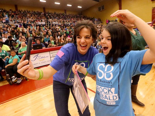 "Riverdale teacher Caron Peack and her daughter Elena Peck, 9, check out their hair after donating at least 8 inches a piece during Riverdale's 4th annual St. Baldrick's Event ""Brave the Shave"" Event on Friday, March 17, 2017.  Riverdale raised over $20,000 to fight childhood cancer during last year's event."