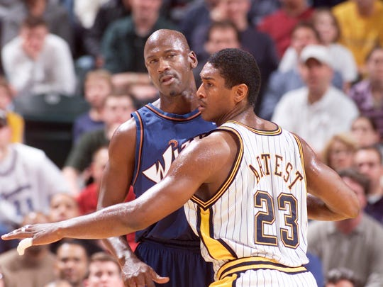 Indiana's Ron Artest guards  Washington's Michael Jordan in the first half of at Bankers Life Fieldhouse.