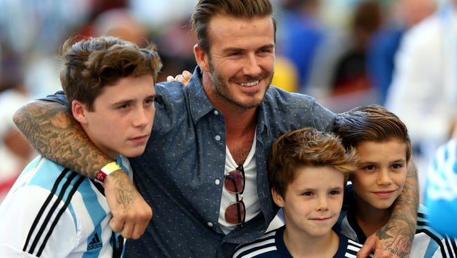 David Beckham and his son Brooklyn, left, were struck by another car on their way back from a youth soccer match.