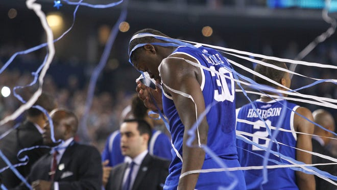 Kentucky's Julius Randle walks off the court as UConn celebrates after beating the Wildcats for the NCAA Championship Monday night at AT&T Stadium. April 7, 2014