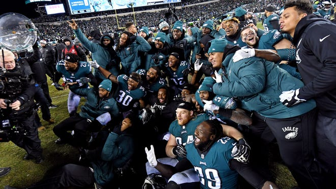 The Eagles celebrate after holding off the Falcons 15-10 to reach the NFC championship game.