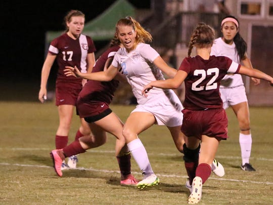 USJ's Abbey Fleming tries for a goal while surrounded