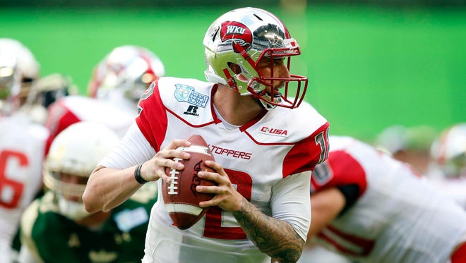 Dec 21, 2015; Miami, FL, USA;Western Kentucky Hilltoppers quarterback Brandon Doughty (12) throws a pass against the South Florida Bulls during the first half in the 2015 Miami Beach Bowl at Marlins Park. Mandatory Credit: Steve Mitchell-USA TODAY Sports